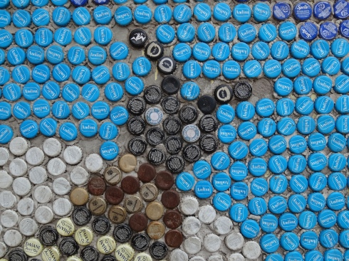 Bee head made of bottle caps